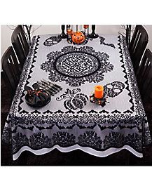 Trick out your treats by serving them on this trick or treat tablecloth!