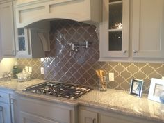 Love this backsplash tile and color.   - Looks like your granite and cabinets.
