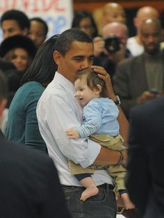 """His smile was so charming, the little guy came pretty close to landing a new home in the White House.  """"Michelle, I think we just decided we're gonna take Jedi home,"""" Obama said to his wife as the couple shook hands with volunteers who had gathered at a local high school to help military families. """"It's pretty tempting, pretty tempting. Of course, I didn't change any diapers yet."""""""