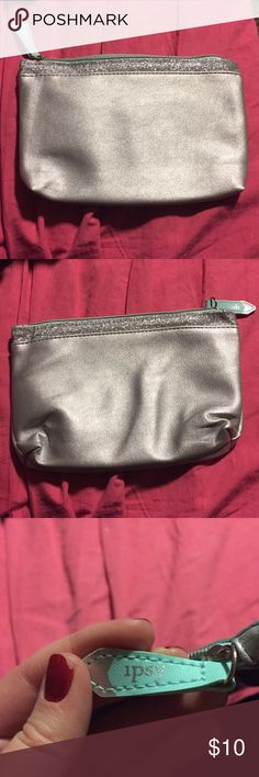 NWOT Ipsy Snow Globe Bag Stylish and perfect for wintertime, this bag is all you need to hold you makeup essentials. Silver with matching sparkles and a hint of mint for the zipper and its tag, this will definitely get you noticed. Ipsy Bags Clutches & Wristlets