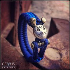 A bracelet from paracord. A bead, the head of a hare in a hockey mask, based on a horror movie. The head is made of jewelry brass, the mask is made of silver. Paracord Bracelets, Survival Bracelets, Edc, Paracord Projects, Hand Ring, Hare, Silver Beads, Unique Jewelry, Hockey