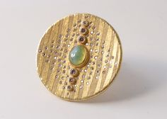 Two tones gold brooch with diamonds and opal.