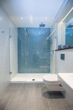 Wooden floor tiles, white wall tiles and aqua blue mosaics in this . - Wooden floor tiles, white wall tiles and aqua blue mosaics in this …, - Bathroom Renos, Bathroom Layout, Modern Bathroom Design, Bathroom Flooring, Bathroom Interior, Bathroom Ideas, Bathroom Designs, Master Bathroom, Shower Ideas
