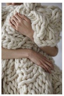 """This fabulous blanket is made with slightly felted roving and homemade """"knitting needles"""" made from pvc pipe. There is a video that shows her making it, and instructions on how to make your own. I must have one!"""