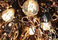 Götti store Lucerne, sunglasses chandelier by Bureau Purée Zurich Titanium Glasses, Visual Merchandising, Rimless Glasses, Lucerne Switzerland, Branding, Design Furniture, Horns, Inventions, Display
