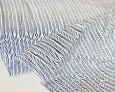 Jersey Knit Fabric, Line Markings in Knit, CAPSULES - Pine Lullaby Collection, AGF Studio, Jersey Fabric, 4 way Stretch Jersey Knit Fabric Fabric Yarn, Knitted Fabric, Art Gallery Fabrics, Photo Lighting, Pine, Organic Cotton, Black And White, Studio, Knitting
