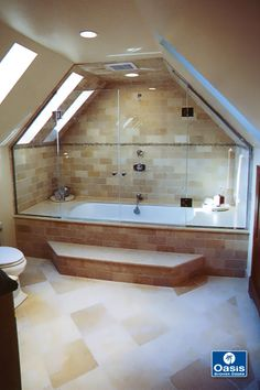 Frameless Custom Tub enclosure features dormer cut fixed panels, glass-to-glass hinges, and french door configuration in clear glass.