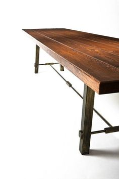 Rustic dining room table with an antiqued steel base - table top is made with 200-year-old salvaged barn wood