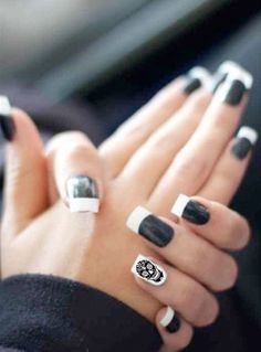 How I might have my nails done. Black base with white tips on every nail except the left ring finger nail. I'll paint that one white with a sugar skull on it.