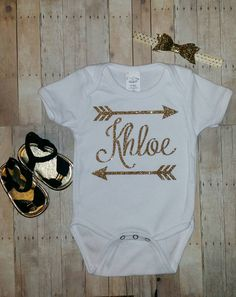 Personalized arrow name baby girl onesie in gold and white glitter   Hey, I found this really awesome Etsy listing at https://www.etsy.com/listing/242575515/personalized-name-arrow-gold-and-white