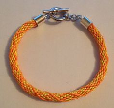 "Orange and yellow ""St Clements"" Kumihimo bracelet by Jewellery by Janine https://www.facebook.com/JewelleryByJanine"