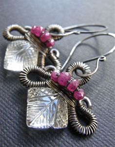 Coronet - wirewrapped earrings featuring rubies and carved rock crystal quartz.  Oxidised sterling silver.