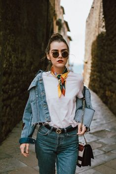 Double denim outfit in Tuscany, castiglione d orcia, italy trip, italy travel guide, andreea birsan travels, couturezilla cute fall outfit ideas 2017, raw hem star printed denim jacket, step hem two tone mom jeans, fishnet socks, gucci inspired blue fur mules, bright blue mules, baby blue, velvet shoes, silk scarf, round sunglasses, gucci logo belt, striped eyelet shoulder bag cavalli class, white t-shirt, white tee, fall outfit created with wardrobe basics, italian getaway in september