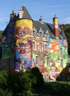 Graffiti art commissioned by Patrick Boyle, the Earl of Glasgow,  for the side of his 13th century Kelburn Castle. Art created by Brazilian graffiti artists Otavio and Gustavo Pandolfo, Nina Pandolfo and Nunca, and originally approved for 3 years, much to the outrage of the neighbors.    Read more: http://www.dailymail.co.uk/news/article-2031274/Earls-bid-make-spray-paint-Scottish-castle-permanent-tourist-attraction.html#ixzz1WfQ7Ymg5