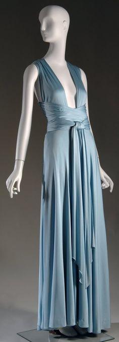 A silk jersey evening dress by Halston, ca. 1972 (gift of Lauren Bacall).