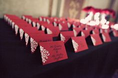 Abby DIYed the escort cards by heat embossing the stamp on the left.