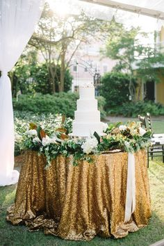 white wedding cake on table with greenery and gold sequin linens http://itgirlweddings.com/16095-2/