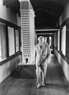 Frank Lloyd Wright in the Hillside corridor, Spring Green, 1957 with the exhibition model for the San Francisco Call Press Building, 1912. - photo by Bill Ray