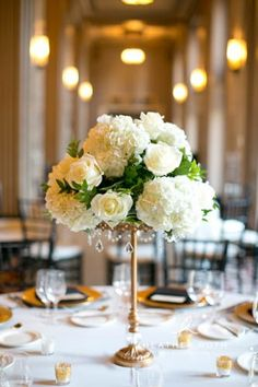 Flowers by Sisters Floral Design Studio www.sistersflowers.net  Photo by Heather Roth Photography-- Gold centerpieces, white and ivory flowers, ivory roses, hydrangea, Peabody Opera House wedding