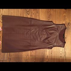Brown pleather shift Brown pleather shift dress. Beach has pleather skirt and the top is a knit material to keep you cool and comfy. Worn twice. 6 The Limited Dresses Mini