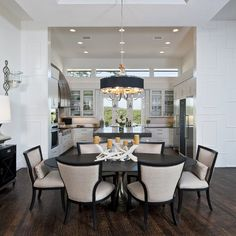 kitchen & dining open to each other - center island, but round dining table