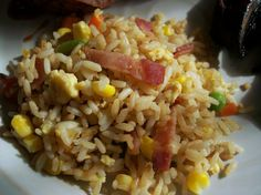 Bacon Garlic Fried Rice from Food.com: This is the fried rice I grew up with. I was never sure if it was just a Filipino recipe or an adaptation my mother made being in the South (US) but all I know is I've never met anyone that didn't like this fried rice and people always beg me for the recipe. The prep time below assumes you already have left over rice in the fridge, but there's instructions for cooling your cooked rice too.