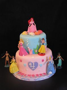 Disney Princess themed birthday cake. This four year old girl's favorite princess was Ariel so the top tier was an under the sea theme.