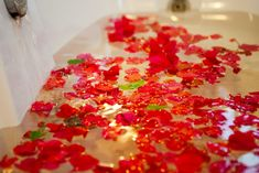 Bath with red roses. Maybe after you took a long relaxing massage, or went to the beach.. kitesurfing?