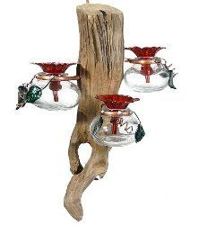 Drifter - Hanging Clear by Perry's Handmade in the serenity of the Great Smokey Mountains, this feeder features decorative bottles and a unique feeding design, solid brass and copper components, the leaves and flowers feature a fired on translucent finish for long lasting durability and beauty. Just fill with liquid hummingbird food and start enjoying the relaxing hobby of bird watching in your own backyard. Perry's - Drifter - Hanging Clear