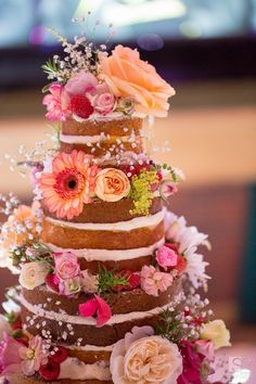 A floral 'naked' wedding cake by Victoria's Sponge in Birmingham. Photographed by S2 Images - www.s2-images.co.uk