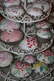 Vintage linens and tart tin pin cushions.