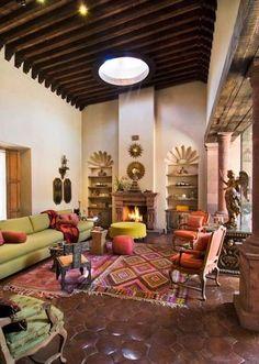 Mexican style. Love the shelves, floor tiles, colour scheme.