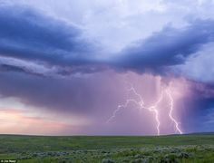 This incredible image shows cloud-to-ground lightning bolts striking a field in eastern Wyoming