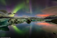 The software engineer's fascinating photos show the green, purple and orange glows reflecting off the surface of the glacial lake