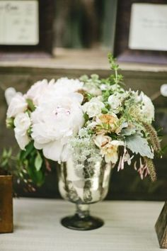 love the vase, in gold this is what I want for main table centerpiece a surrounded buy small single flower or mini bunches and candles