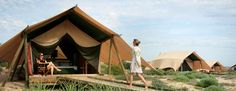 Stay in roomy safari tents nestled in Australia's western dunes. This resort borders a national park and offers from-the-beach access to coral reefs teeming with tropical fish. Go Glamping, Camping, Luxury Glamping, The Places Youll Go, Places To Go, Western Australia, National Parks, Outdoor Structures, House Styles