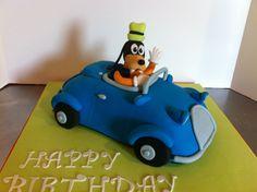 Fondant goofy driving car cake made using Wiltons 3D cruiser pan.