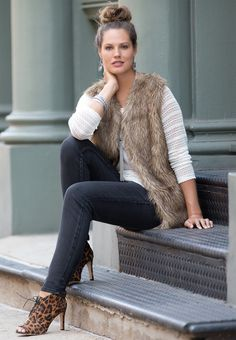 Wild Ones | Strut your way through the season in our faux fur vest atop our crochet inset slub knit top. Wear them with black jeggings and leopard pumps for a street chic look.