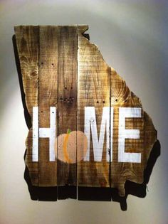 "52 Unique Christmas Gift Ideas for the Home Made from pallets and reclaimed wood in the shape of a state, these home decor plaques are a trending Christmas gift idea for the home. This one, shaped like the great state of Georgia and painted with a peach inside the word ""home"", is just one of dozens offered by Campground Production."