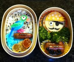 The best bentos I've ever made were the set of two pirate themed ones for this year's Talk Like a Pirate Day. This was the second one, with a parrot by special request. The parrot is kamaboko (fish cake), its perch is a chicken-apple sausage, the rice is seasoned with furikake (upper) or food-colored blue (lower). The pirate is cheese and cracker, with a candy eye and nori details.