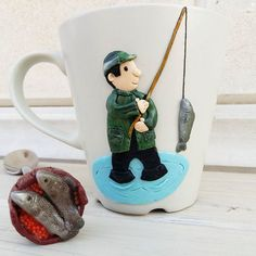 Рыбки дождались своего  рыбака #вкусныеложки #вкусныекружки #подаркиростов #полимернаяглина #фимо #ручнаяработа #сделанослюбовью #идеяподарка #лепка #декор #кружканазаказ #творчество #подарок #ростов #рыбалка #дон #рыбак #рыба #рыбаки_и_рыбки #инстамама #ручнаяработаназаказ #творчество #креатив #арт #хобби #хэндмэйд #handmade #fimo #clay #handmaderostov