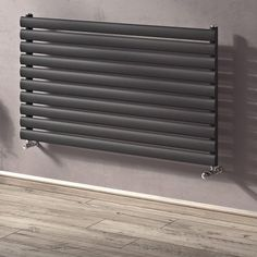 The Eucotherm Nova Anthcracite Horizontal Radiators are a simple yet stylish design that come in singular tube and in double. Comes with a 10 year guarantee. Horizontal Designer Radiators, Blinds, Nova, Tube, Stylish, Simple, Home Decor, Decoration Home, Room Decor