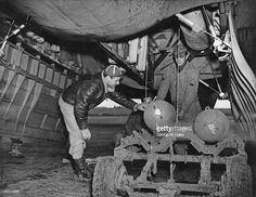 American ground crew loading bombs into a Flying Fortress bomber at an Eighth Air Force airfield in England, December Ww2 Planes, Ww2 Aircraft, Air Force, Army, History, American, 18th, December, England