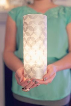 DIY Tissue Covered Vase. I have so much tissue paper left over from Christmas. I am totally doing this.