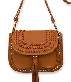 Studded tassel saddle bag with braid trim on flap.
