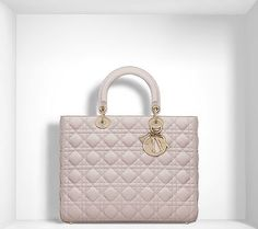 An iconic bag for a look worthy of a true Lady. It is carried in the hand to add the finishing touch to a look that's so Dior: An iconic bag from the House of Dior, the Lady Dior features the woven 'cannage' design found on the Napoleon III chairs that Christian Dior loved so dearly. - bags, prada, hermes, lunch, tote, leather bag *ad
