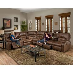 Add luxurious comfort to your living room with the Dakota Collection. This rustic set is made up of a reclining sofa with a drop down table, a corner wedge and a console loveseat all in gorgeous brown upholstered faux leather.