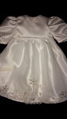 A micro preemie gown. For a 1 to 3 pound baby. This one has a tiny pearl necklace that I designed from decorations off of the head piece. My Sister Sherry did the dress.