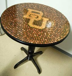 """Penny-tiled table for a <a class=""""pintag searchlink"""" data-query=""""%23Baylor"""" data-type=""""hashtag"""" href=""""/search/?q=%23Baylor&rs=hashtag"""" rel=""""nofollow"""" title=""""#Baylor search Pinterest"""">#Baylor</a>-themed game room. How unique!"""