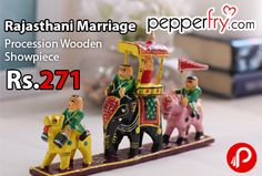 Pepperfry is offering Little India Multicolour Wooden Rajasthani Marriage Procession Showpiece just Rs.271. Honor the Maharaja's troupe by bringing home the Multicolor Wooden Rajasthani Marriage Procession Showpiece from Little India. The colorful scene involves a camel rider followed by the Maharaja's palki on an elephant and a horse rider. Inspired by Meenakari artwork, this wooden ...  http://www.paisebachaoindia.com/rajasthani-marriage-procession-wooden-showpiece-just-rs-271-pepperfry/